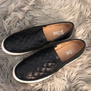 Black slip on shoes worn a couple times